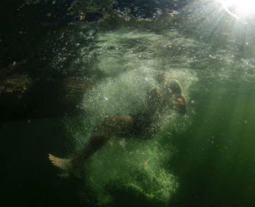 what to do to feel happier person submerged in water