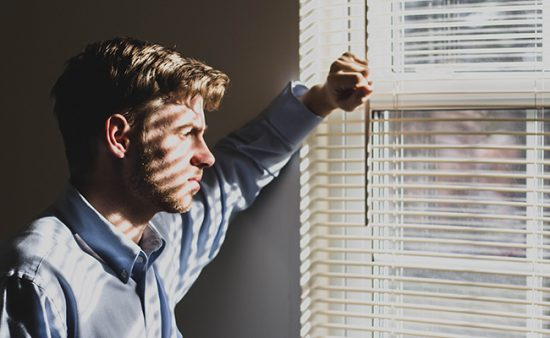 depression symptoms man staring out window