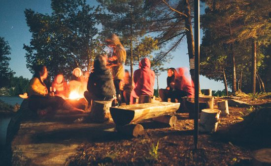 depression symptoms people gathered around campfire