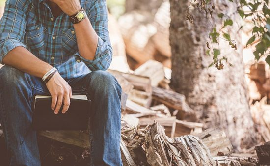 how to get rid of anxiety man sitting alone in woods