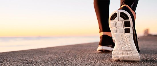 weight loss tactics runner's sneakers on pavement