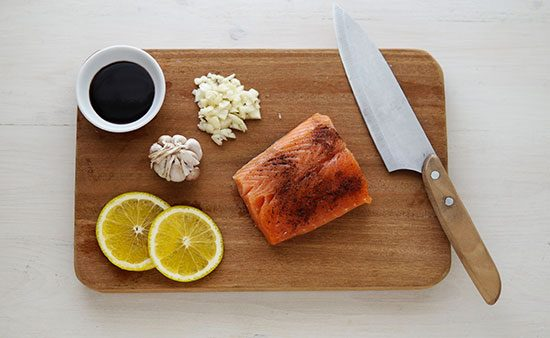 diets that work salmon with garnishments on cutting board