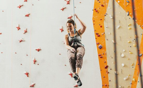 do i need a life coach woman climbing at indoor gym