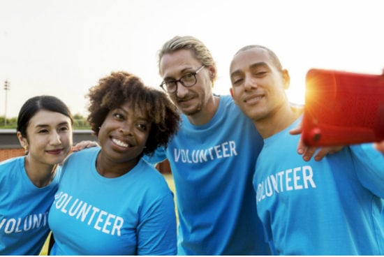 group of volunteers smiling
