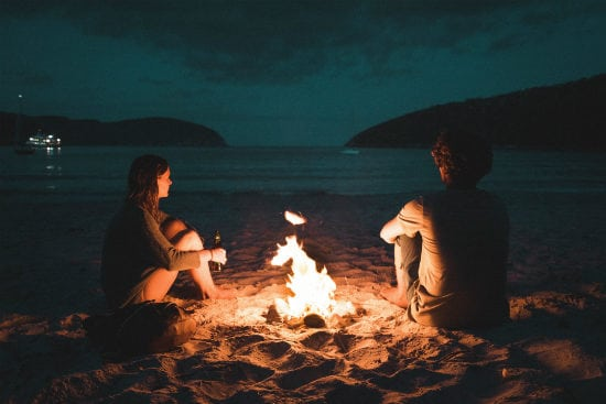 couple-sitting-by-fireplace