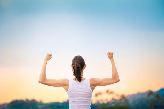 how_to_achieve_goals_woman_flexing_arms