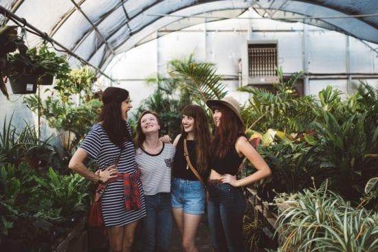 four girls in the garden