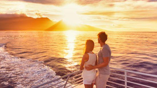 couple enjoying sunset with joy
