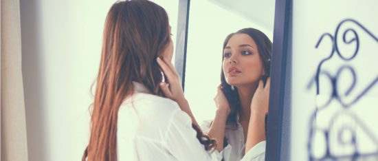 women looking into a mirror self love